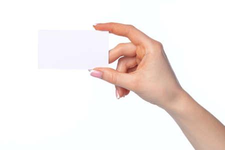 Beautiful female hand holding white business card isolated on white background
