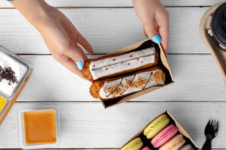 Fresh eclair cakes in a cardboard box close up