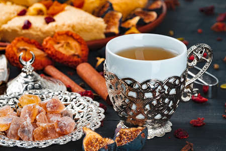 Close up photo of turkish national desserts with cup of coffee on table