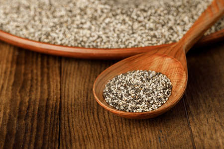Wooden spoon with chia seeds close up