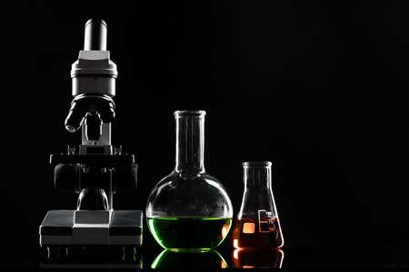 laboratory microscope on table in the dark
