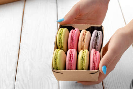 Colorful macaron cookies in a cardboard box close up
