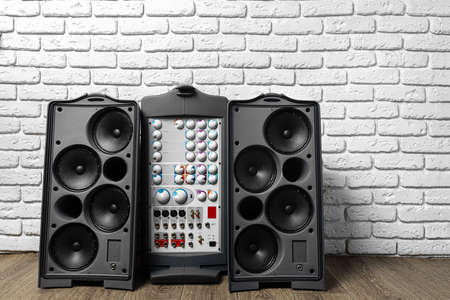 Modern stereo audio system with large speakers and amplifier