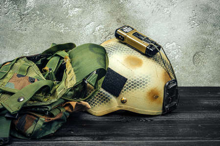 US military helmet on wooden background close up Stok Fotoğraf