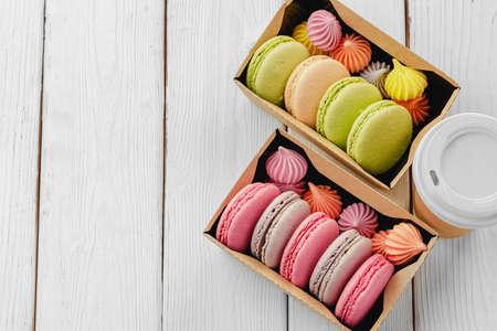 Colorful macaron cookies in a cardboard box