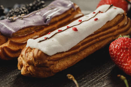 Eclair cake decorated with berries close up