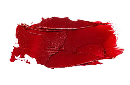 Lipstick swatch sample on white background. Close up.