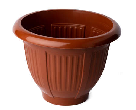 Brown plastic flower pot isolated on white