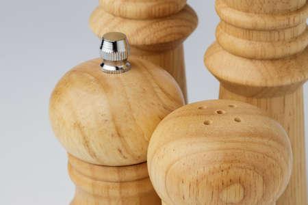Wooden mills with salt and pepper on white Reklamní fotografie