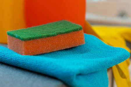 Cleaning sponge and rag on kitchen counter