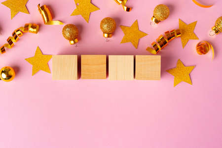 Four wooden blocks with deocrative stars. New Year concept