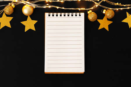 Blank sheet of paper with golden decorative stars. New year resolutions concept 版權商用圖片
