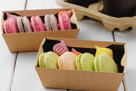Colorful macaron cookies in a cardboard box
