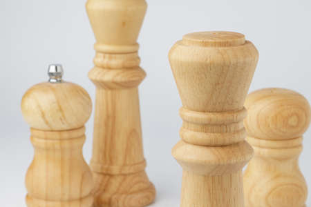 Wooden mills with salt and pepper on white Standard-Bild