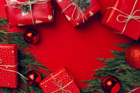 Red festive Christmas background with coniferous branches