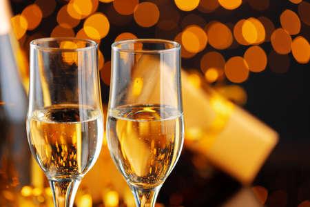 Champagne glass on blurred garland lights background Archivio Fotografico