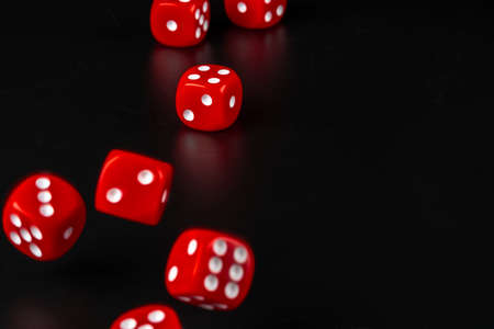 Group of dice close up on dark black background