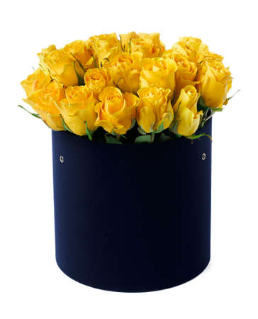 Yellow roses in a hat box isolated on white background