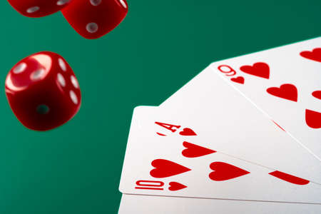 Playing cards with red dice. Casino and gambling concept Stock Photo