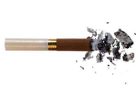 Lit brown cigarette isolated on white background