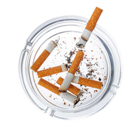 Burnt cigarette butts in an ash tray isolated on white