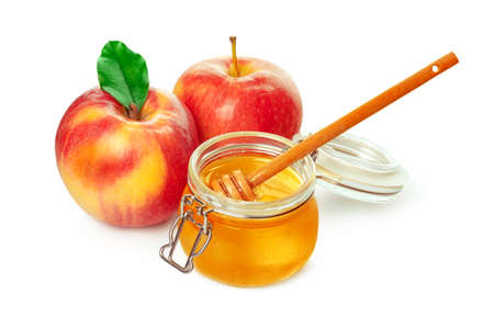 Apples and honey jar for jewish new year holiday isolated on white background. High quality photo Stock fotó