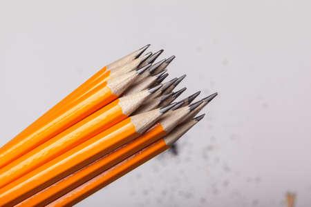 Orange pencils close up isolated on white background. High quality photo