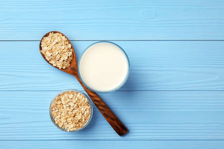 Non dairy oat milk and oat flakes in bowl Reklamní fotografie