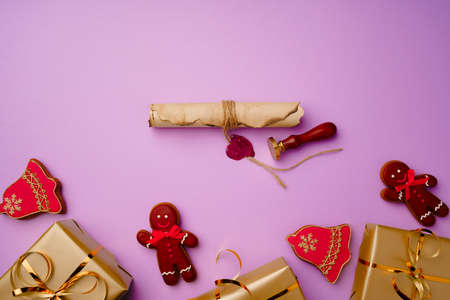Flatlay composittion with Santa list and wrapped gift boxes on purple background