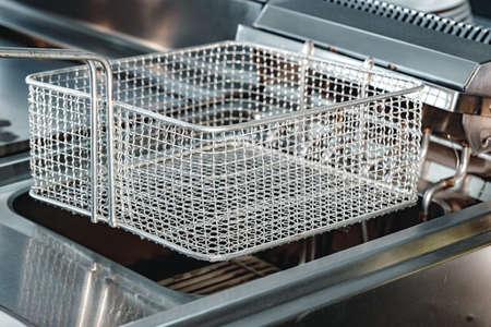 New industrial deep fryer equipment close up Standard-Bild