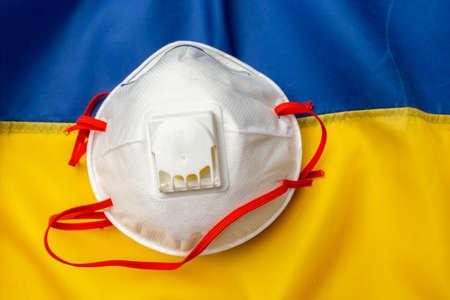 Medical face masks on flag of Ukraine