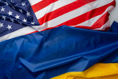 Flags of Ukraine and Usa folded together