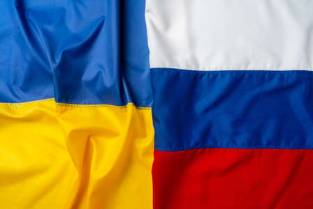 Flags of Russia and Ukraine folded together
