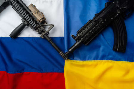 Flags of Russia and Ukraine folded together with rifle guns Stock fotó