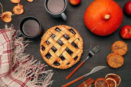 Thanksgiving pie and pumpkin on black background