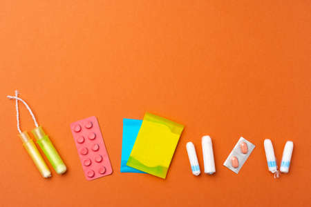 Flat lay of Pads, tampons and pills Banco de Imagens