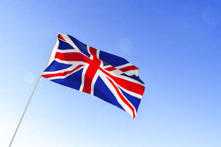 Flag of Great Britain waving against blue sky