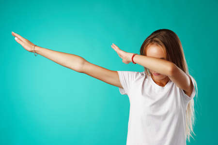 Young woman showing dab dance move close up