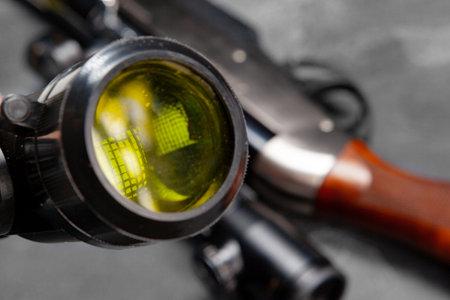 Optical sight of hunting rifle on grey background Stockfoto
