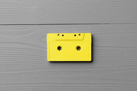 Yellow audio cassettes on gray background top view Banque d'images