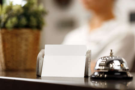 Hotel service bell on front desk counter Stock Photo