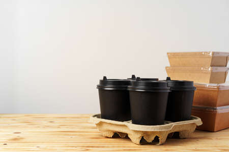 Paper bags with take away food and coffee cups containers