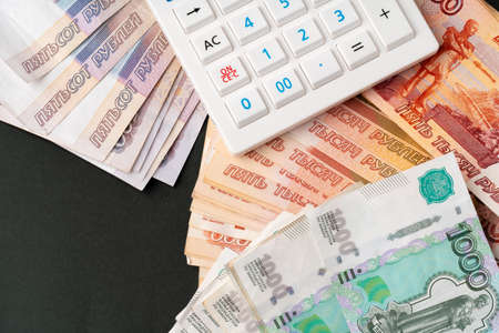 Close up photo of stack of Russian money rubles with calculator