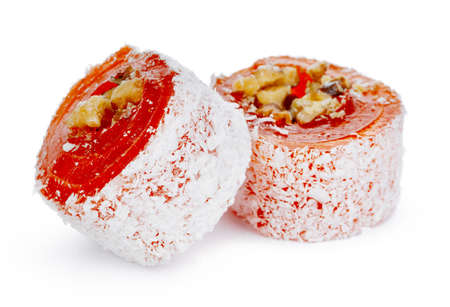 Orange Turkish delight with nuts in powdered sugar isolated on white