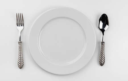 Empty plate with cutlery isolated on white background Stockfoto