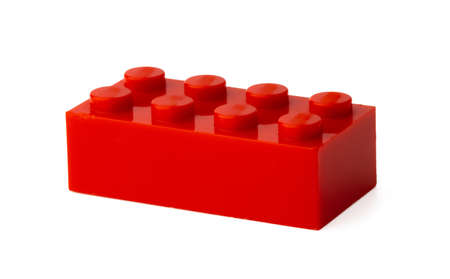 Colored plastic toy building block isolated on white