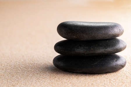 Japanese zen garden meditation stone in sand Stock Photo