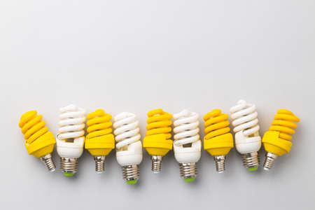 Light bulb on light grey paper background