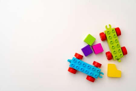 Details of kids plastic constructor on white background Standard-Bild