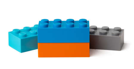 Colorful plastic toy building blocks isolated on white Imagens